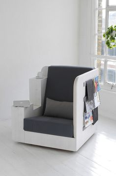 The perfect reading nook/chair, complete with bookshelves & magazine storage