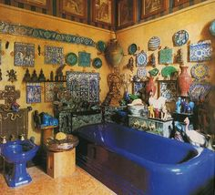 Bohemian bathroom with display of tile and pottery.