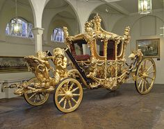 The Royal Family's Carriage ~ The Gold State Coach, 1760, by Sir William Chambers. Oh my!