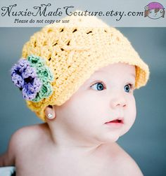 Nuxie is one of my favorite Etsy sites! Bella has a brown/pink beanie from 2 years ago and an adorable Owl dress we just got :)  I want this yellow hat!
