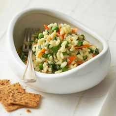 Spring Peas Risotto - Add the broth slowly to the rice in this nutrient-rich Italian classic side dish to help the rice cook up extra creamy.