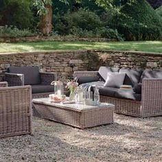 The elegant Harting Rattan Garden Soft Set will create the most luxurious outdoor seating. Durable and weather proof, the set comprises a generously sized three-seater sofa, two armchairs and a glass topped coffee table and is perfect for your patio, terrace or conservatory.
