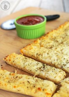 Cheesy Garlic Breadsticks - Easy breadsticks topped with gooey cheese and Italian seasonings. Perfect paired with Red Baron® Thin & Crispy Pizzas!