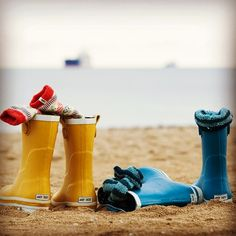 Kick off your wellies and go for a winter paddle on Gyllyngvase Beach, Falmouth. Cornwall.