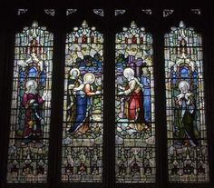 Stained glass in Wales: The Visitation with Simeon and Anna    Photo © Martin Crampin    larger image  about 1910    Four-light window with the Visitation in the two central lights (Elisabeth greeting Mary with Joseph and Zechariah in the background), flanked by standing figures of Simeon and Anna.