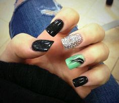 Black and Green Nails with Glitter and a Feather