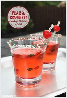 Pear & Cranberry Holiday Cocktail | pear vodka, cranberry juice, sprite, maraschino cherries for garnish | Served in sprinkle rimmed holiday glasses! | Christmas party drink ideas