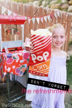 Host a backyard movie night for the neighborhood, complete with a popcorn bar and candy!
