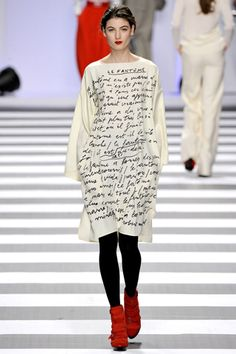 Dress with graphic of text from the Fantome written by Robert Malaval designed by Jean Charles de Castelbajac.
