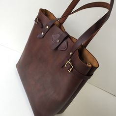 Here is an example of the Gillie Leather tote shape but in a thicker leather that has been hand dyed. I don't have much of this discontinued hide, so if you like this look, order soon before I run out. I can dye this leather to your color preference.