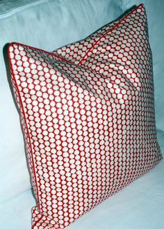 """Here's a Christmas pillow which will be welcome long after the holidays are over.  Hable Construction """"Cherry Picker"""" Pillow Cover.  Modern Coastal Interiors (Etsy)"""