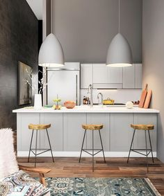 Blend modern decor elements for a jaw-dropping kitchen. Remodel the space to include slab cabinets and a peninsula counter. Line it with midcentury counter-height chairs. Hang statement pendants with…More Small Modern Kitchens, Modern Kitchen Design, Kitchen Interior, Kitchen Decor, Kitchen Ideas, Kitchen Sinks, Kitchen Upgrades, Kitchen Layout, Modern Decor