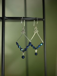 Earrings - silver wire, blue crystals with wirework and a crystal drop.