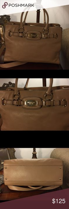 MICHAEL KORS TAN LARGE BAG Very nice Michael Kors shoulder bag. This is a large bag with more pockets than I know what to do with. It's a tan pebble leather different than the saffiano leather. It is much softer and not as rigid as saffiano. I have cleaned this bag inside and out so that when you get it its ready to go. Smoke and fur baby free house. MICHAEL Michael Kors Bags Shoulder Bags