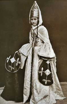 Abazin woman. Presumably, the Terskaya region, late 19th century.  Note the silver plasteron on her chest.
