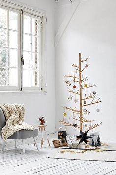 Ideas and inspiration for alternative Christmas decorations, from Scandi trees and paper baubles to gift wrapping suggestions