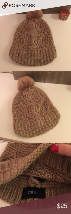 New Surell Camel Faux Fur Pompom hat New never worn (got as gift) beautiful Knit beanie with faux fur quality pompom feels and looks real. Nice camel color. Well known brand Surell bought at Nordstorms. Selling much cheaper than retail!! Accepting best 🎀🎀🎀 Surell Accessories Hats