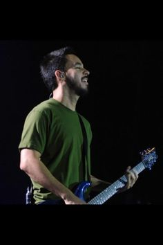 Mike Shinoda in a green t-shirt :)