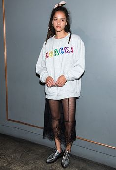 Believe it or not, a throwback to that primary school thing just made your wardrobe wish list. American Honey actress Sasha Lane brings the clash-it cool with an oversized 'Snacks' sweat layered over a dressy, sheer lace skirt. Continue in the fun vein with cutesy accessories: pointed magpie brogues and a baby-girl hair bow