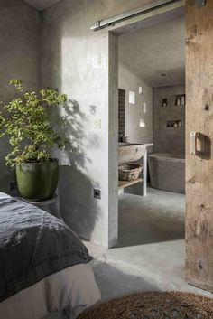 Modern-rustic cottage hideaway near Perranporth beach & Holywell Bay in Cornwall with hot tub. A luxury cottage with architectural design House Design, Rustic Master Bedroom, Luxury Cottage, Cottage, Home, Modern Rustic, Concrete Bedroom, Concrete House, Modern Rustic Master Bedroom