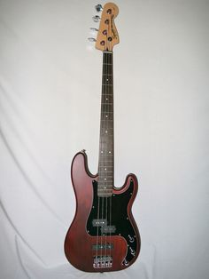 Indian Creek Guitars - Squier Standard Precision Bass Special - Satin Walnut, (http://www.indiancreekguitars.com/squier-standard-precision-bass-special-satin-walnut/)