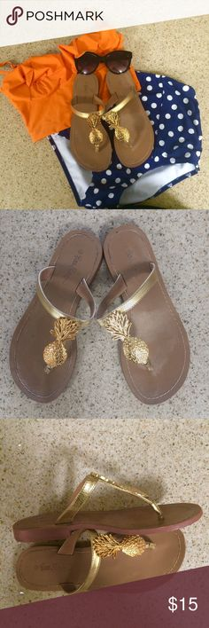 Lilly Pulitzer gold pineapple sandals  Adorable Lilly Pulitzer for Target gold pineapple sandals! Size 6 and fit true to size. They've been lived but still in good condition--some stretching on the plastic band over the foot. Lilly Pulitzer for Target Shoes Sandals