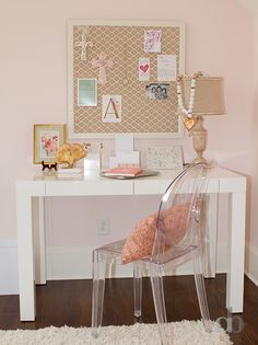 White and pink kid's room features cotton candy pink walls lined with a framed brown lattice pin board over a West Elm Parsons Desk with Drawers paired with a clear acrylic chair, Kartell Victoria Ghost Chair.