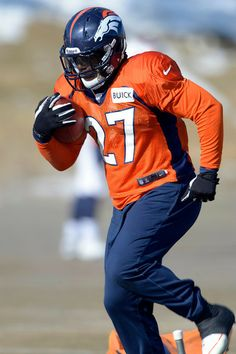 Description of . Denver Broncos running back Knowshon Moreno (27) runs through drills during practice January 23, 2014 at Dove Valley. (Ph...