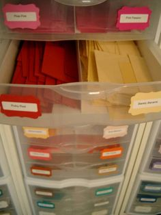 I finally came up with a system for my card stock scraps. I bought twelve 3-drawer containers from Wal-Mart. In each drawer, I put a divider I made from two sheets of Wal-Mart white card stock scored and glued together.