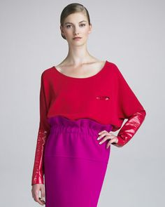 Who in their right mind would 1) intentionally wear an outfit shaped like this, 3) wear red and purple together or 3) spend $680 for just the blouse part?
