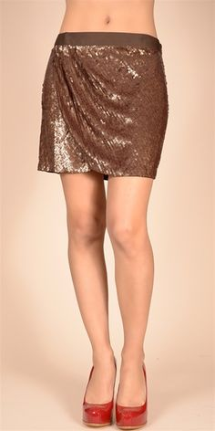 This embellished silk miniskirt features all over embroidered sequins with pleating at the faux wrap detail. Hidden side zip at grosgrain waistband. Lined.100% silkDry clean only