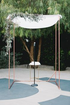 copper pipe ceremony arbor .  Marble Rye Photography