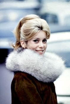 CATHERINE DENEUVE HAS  BIT OF A TIPPET GOING ON. THE HOKEY POKEY MAN AND AN INSANE HAWKER OF FISH BY CONNIE DURAND. AVAILABLE ON AMAZON KINDLE.