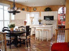 Mediterranean kitchen concept - I like the plates on the walls and the tiling between the cabinets.  Also, the mustard and orange wall color.