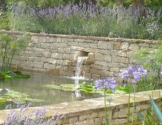 water chute in cotswold stone wall