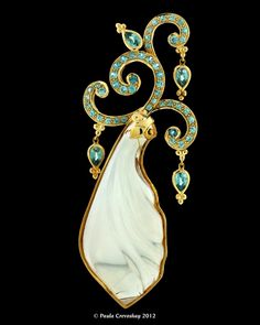 Lawrence Stoller and Paula Crevoshay.  Strollers' carved Oregon Opal with gold work accented by Blue Zircons from Cambodia.