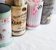 Tin cans covered with vintage paper