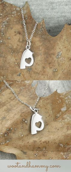 a tiny perched bird has a sweet cutout heart in this sterling silver necklace.