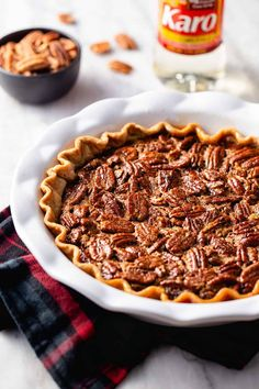 Chocolate filling and pecans make for the best Chocolate Pecan Pie. No Thanksgiving would be complete without a slice of this chocolatey pie!