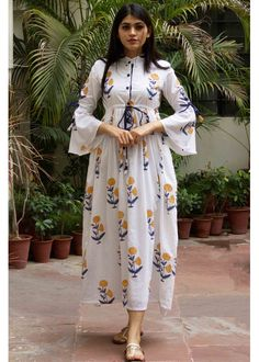 Discover Latest & Trendy Clothing & Accessories like White Base Yellow Butta Dress online in Best Price! Sleeves Designs For Dresses, Shrug For Dresses, Dress Neck Designs, The Dress, Stylish Dress Designs, Stylish Dresses For Girls, Kurta Neck Design, Kurti Sleeves Design, Pakistani Dresses Casual