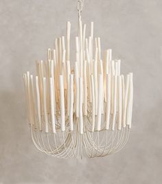 Tiered Tapers Chandelier, presented by Anthropologie.White-washed agar wood twigs reach out from iron stamens on this curving made to order chandelier. Chandelier Bougie, Chandelier Lighting, White Chandelier, Stairwell Chandelier, Candle Chandelier, Park Lighting, Unique Chandelier, Wooden Chandelier, Unique Lighting