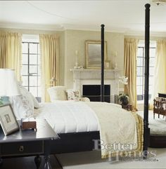 four poster bed, fireplace, nice wood end tables, and neutral tones. A little more formal in the master because that's the one room the kids won't mess up!
