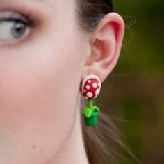 Show off your nerdy Mario side with the Piranha Plant Earrings. These custom made earrings are modeled after the always troublesome piranha plants from the Super Mario games, and have a clever design where it looks like the plant is biting on your ears. Super Mario Bros, Geek Jewelry, Clay Jewelry, Jewlery, Mom Jewelry, Jewelry Ideas, Earring Backs, Earring Set, Earring Studs