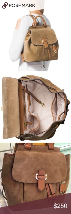 """Spcl‼️MK Romy medium backpack desert suede Cast in sumptuous suede with luxe contrast trim, this MICHAEL Michael Kors backpack blends sophisticated style with a sporty silhouette that lasts all day and into the night. 13"""" W x 11-1/2"""" H x 3-1/2"""" D Interior features 1 zip pocket, 2 utility pockets, 1 slip pocket and key clip 14""""-16""""L adjustable backpack straps Drawstring and push-lock closure Exterior features 1 front slip pocket and hanging logo medallion Leather; lining: polyester…"""