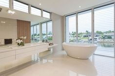 Flooring Ideas, Modern Bathroom Design Ideas With White Bathroom Epoxy Floor And Wall Mounted Bathroom Vanity Under Large Frameless Mirror Also Round Freestanding Bathtub: Create The Attraction To The House Through The Epoxy Floor