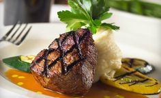 Groupon - Steak and Seafood Meal for Two or Four Monday–Thursday or Friday–Saturday at Blackstone (Up to 57% Off) in Smyrna. Groupon deal price: $50.00