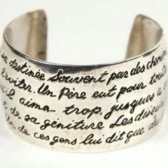 ISO Carolee 925 cuff bracelet French inscription ISO of this bracelet. CAROLEE  925 sterling silver, five lines of french inscription. Made in 1992 If you have this and are willing to let it go, please tag me and I would be happy to negotiate with you. Vintage Jewelry Bracelets
