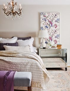Framed fabric in a whimsical print acts as art in this traditional bedroom, injecting color and drama to the otherwise pale, creamy palette. | Photographer: Donna Griffith | Designer: Cameron MacNeil