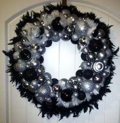 Decorative feather wreath with black, white, silver tones, and zebra print shatterproof ornaments on Etsy, $125.00