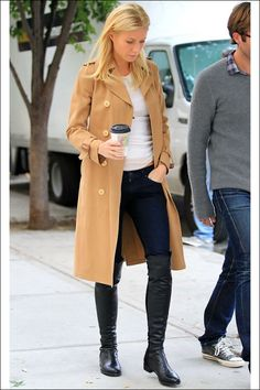 A true classicist when it comes to her taste in style, Gwyneth Paltrow completes her early fall look with a tan trench and the cult-favorite Stuart Weitzman 50/50 boots.